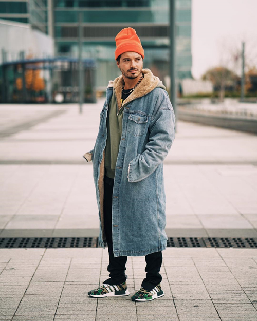 J-Balvin-Fear-of-God-coat-sweater-Open-Ceremony-beanie-Adidas-Original-sweatpants-Bape-NMD-sneakers.jpg