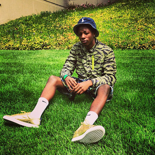 Joey-Bada-in-the-UNDFTD-x-Puma-Clyde-Gametime-Metallic-Gold.jpg