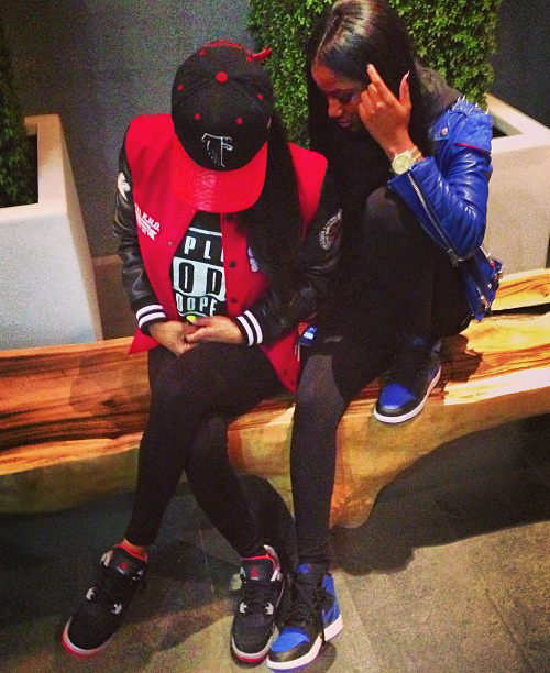 Teyana-Taylor-in-the-Air-Jordan-4-Black-Red.jpg