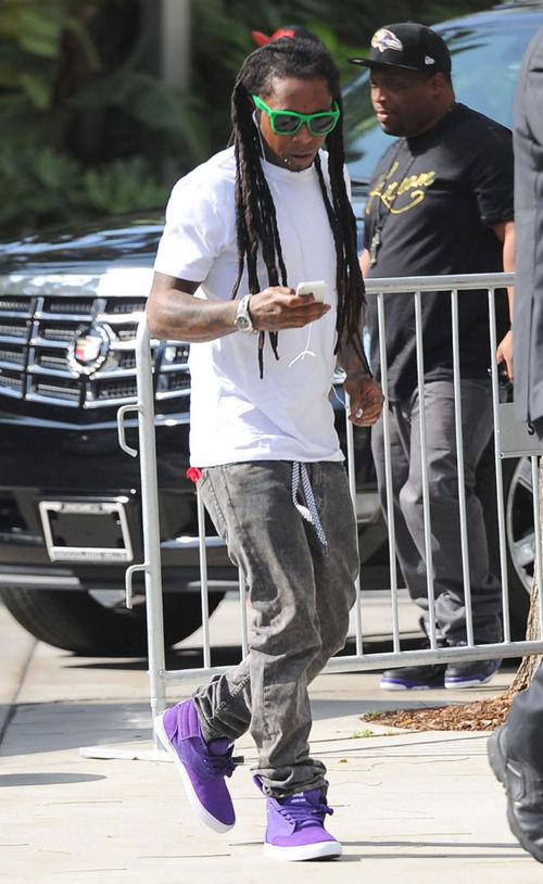 lil-wayne-in-the-supra-passion-purple-white.jpeg