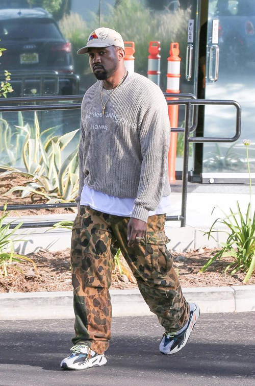 Kanye-West-Comme-des-Garcons-Homme-sweater-Adidas-Yeezy-runner-sneakers-Armor-School-hat.jpg
