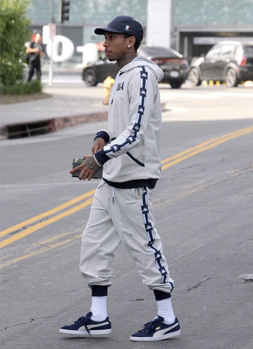 Tyga-Louis-Vuitton-hat-LV-wallet-Kappa-hoodie-sweatpants-Puma-sneakers.jpg
