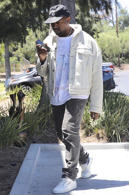 Kanye-West-Public-Enemy-hat-denim-jacket-Adidas-Powerphase-sneakers.jpg
