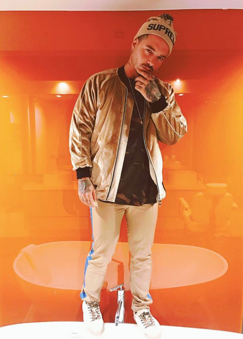 J-Balvin-Cease-Desist-jacket-Supreme-knit-hat-Valentino-trousers.jpg