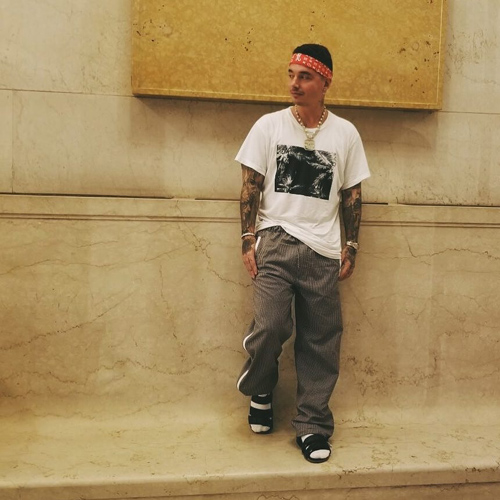 J-Balvin-Louis-Vuitton-Supreme-bandanna-Amiri-t-shirt-Prada-pants-Louis-Vuitton-sandal.jpg