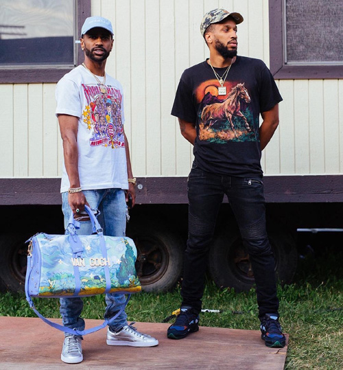 Big-Sean-Earlly-Mac-Mania-Merch-hat-Puma-sneakers-Louis-Vuitton-Jeff-Koons-bag.jpg