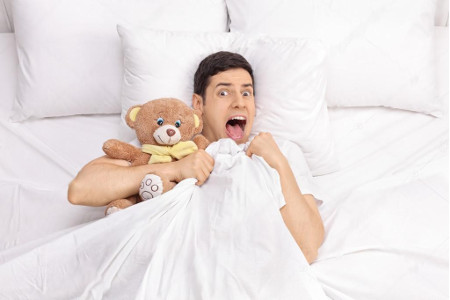 depositphotos_110316680-stock-photo-terrified-man-laying-in-bed.jpg
