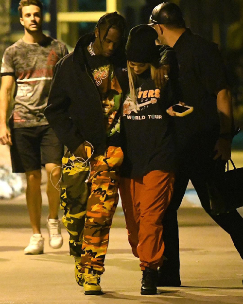 Travis-Scott-Kendall-Jenner-Tiger-Woods-tee-Rokit-camo-pants-Air-Jordan-sneakers-3.jpg