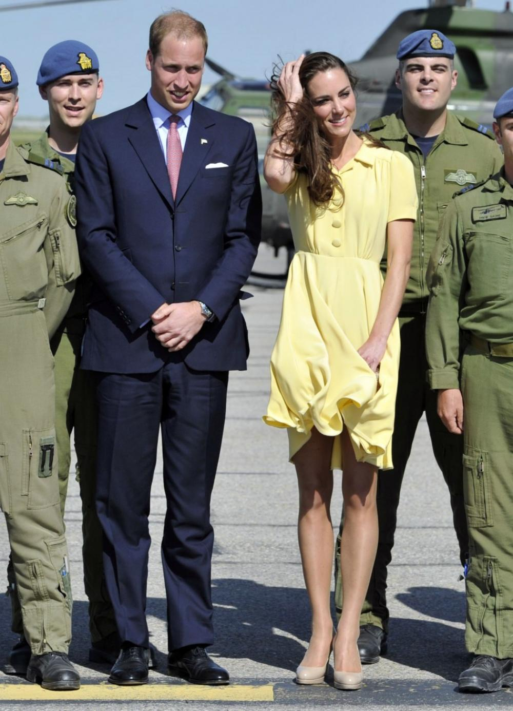 126607-britains-prince-william-and-his-wife-catherine-duchess-of-cambridge-po.jpg