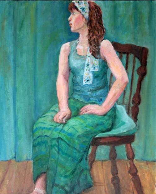 青い服の女
